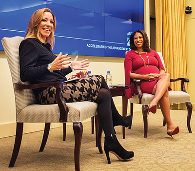 Lisa Wardell and Courtney Gibson at a panel discussion.