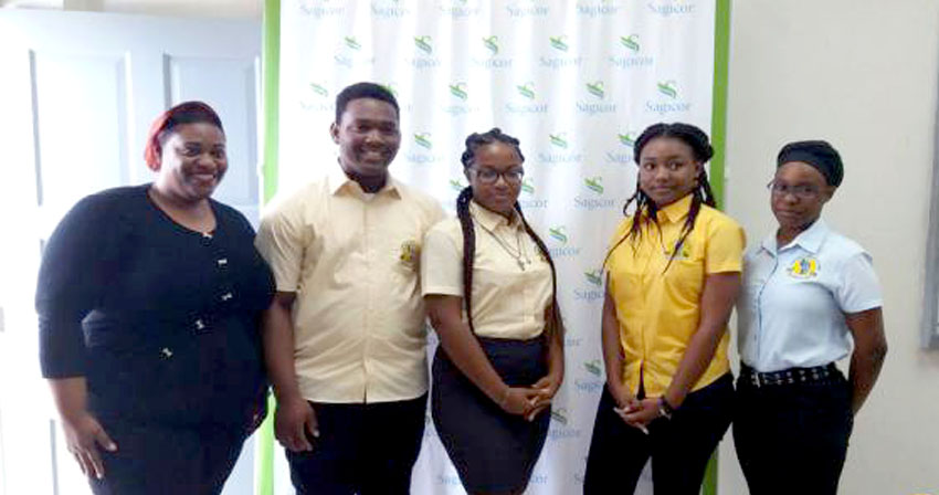 Team Dominica is Ashfred Norris, Kareen George, Tarrie Anselm and Jair Pendenque with Coach Trudy Christian