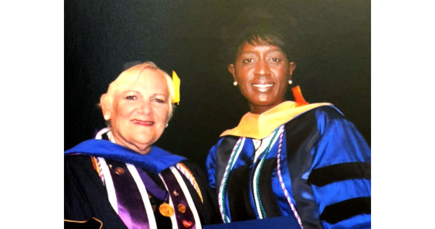 Dr. Melani Bell with Dr. Susan Goenwald at graduation