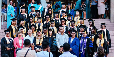 Seychelles graduates lined up on stairs for a photo