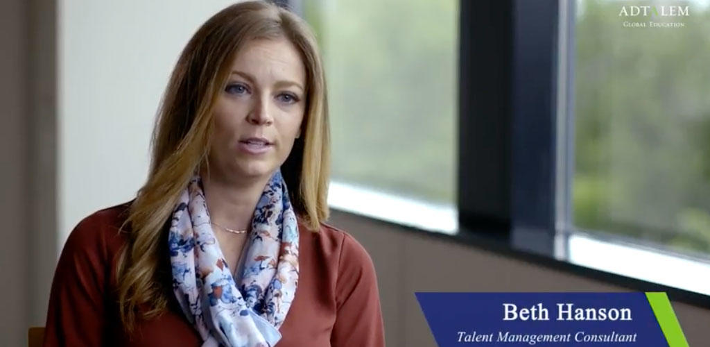 Video still frame of Beth Hanson in an interview