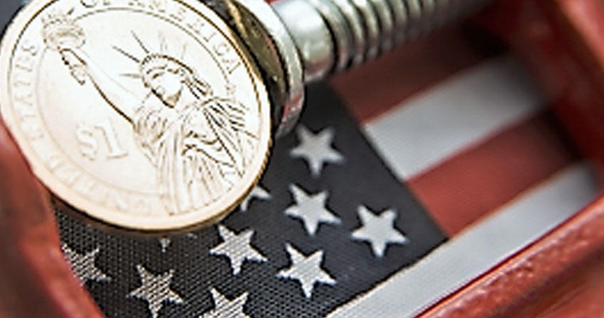 macro photo of coins on top of an American flag