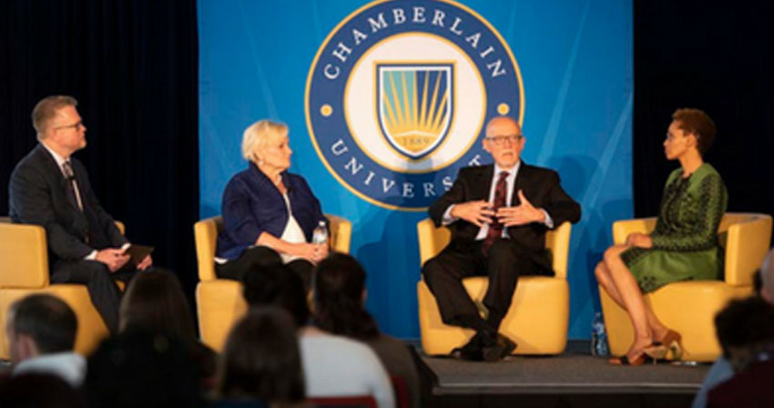 Chamberlain leaders speaking at a panel on stage