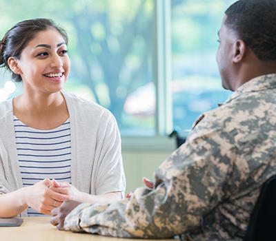 Woman talking with a man in army fatigues