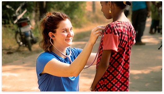 global nurse examining a child with a stethoscope